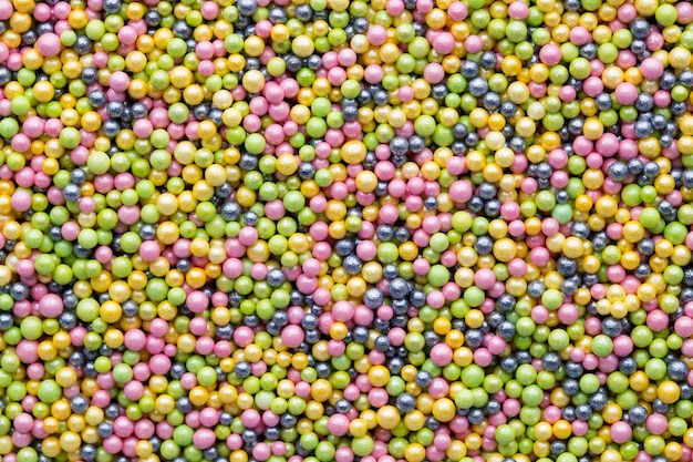 Multicoloured sweet sugar balls. small ball texture background.