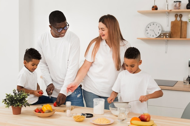 Multicultural family cooking together