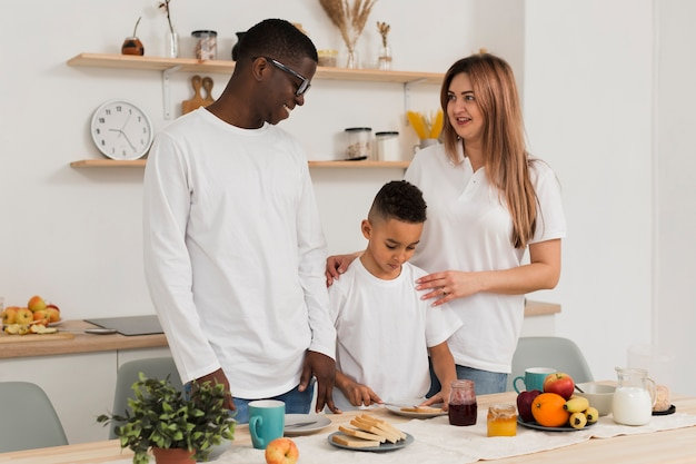 Multicultural family getting ready to eat