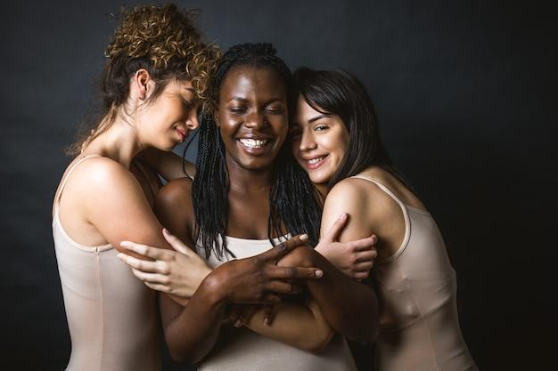 Multicultural group of beautiful women posing in underwear