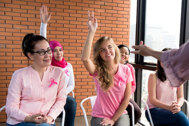 Multiethinic women meeting for breast cancer awareness campaign