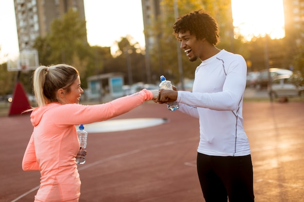 Multiethnic couple doing sport outdoors
