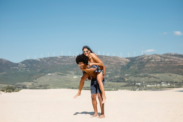 Multiethnic couple having fun on beach
