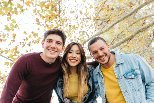 Multiethnic friends smiling and embracing