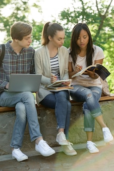 Multiethnic group of young concentrated students