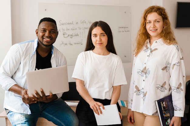 Multiethnic students and teacher study foreign languages together in class