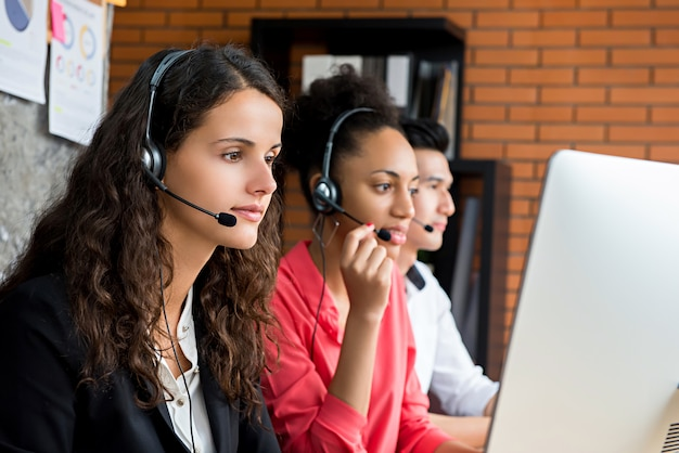 Multiethnic telemarketing customer service agents, call center job concept