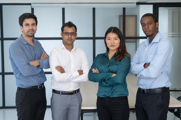 Multiethnic work group posing in modern office.