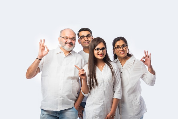 Multigenerational indian asian smart family wears clear eye glasses or spects or spectacles against white background