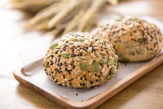 Multigrain mixed cereal seed healthy bread bun in wooden plate