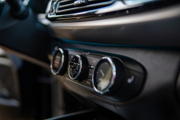 Multimedia control console and climate in a modern car closeup selective focus no people
