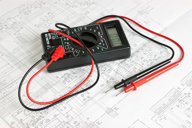 Multimeter on the background of electronic circuits