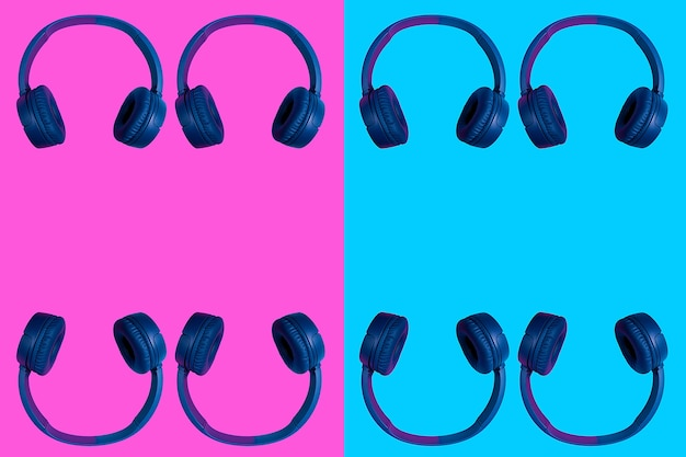 Multiple doubled wireless headphones on two colored background. flat minimal style. design and colors