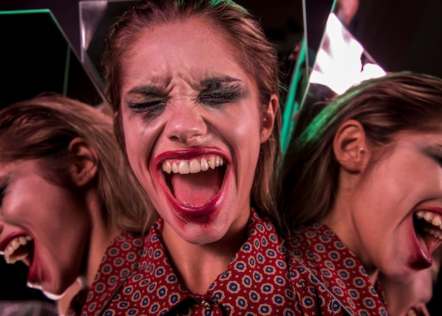 Multiple mirror effect of woman screaming with eyes closed