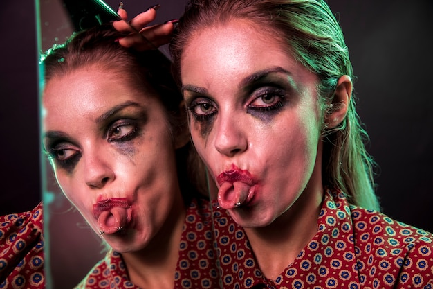 Multiple mirror effect of woman sticking her tongue out