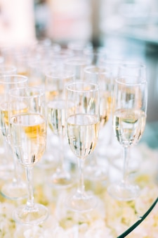 Multiple wineglasses on catering table