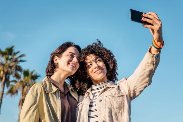 Multiracial couple of gay women taking a photo