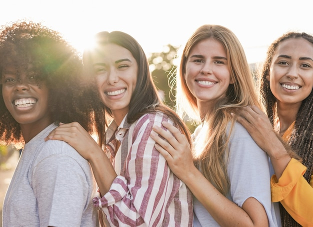 Multiracial diverse women standing in a line and smiling on camera. friendship and happiness concept