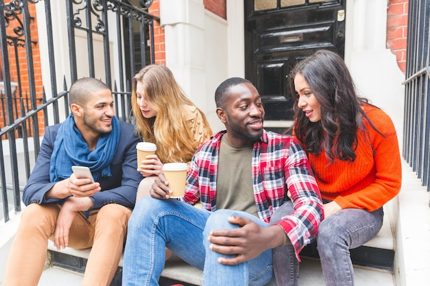 Multiracial group of friends having fun together in london