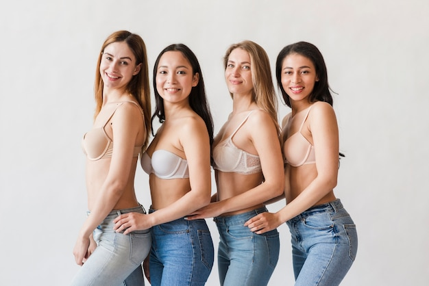 Multiracial group of happy women posing in bras