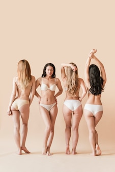 Multiracial group of women posing in underwear