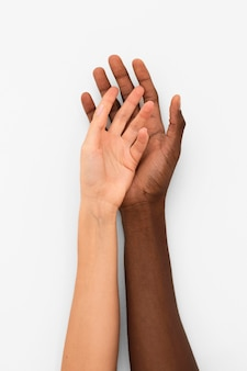 Multiracial hands coming together