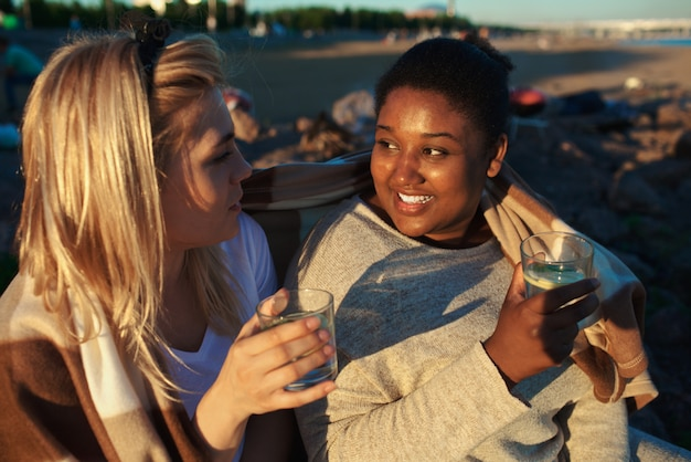 Multiracial women drinking on party