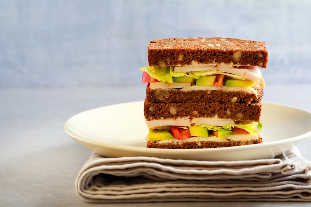 Multiseed avocado smoked chicken breast and tomato sandwich