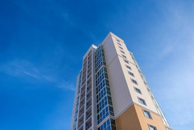 Multistorey residential house on blue sky background
