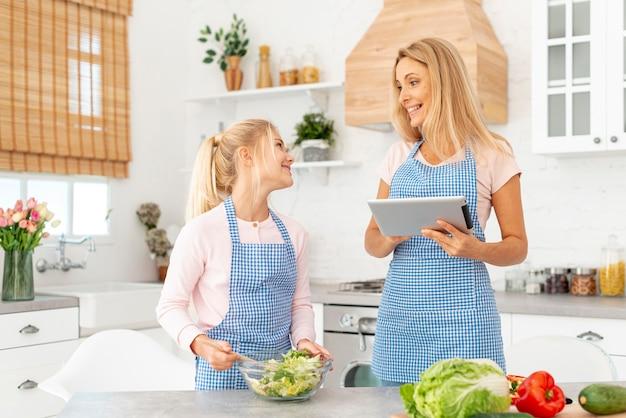 Mum and daughter preparing salad