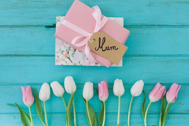Mum inscription with tulips and gift