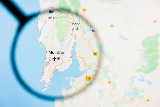 Mumbai, india city visualization illustrative concept on display screen through magnifying glass