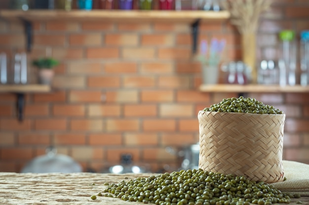 Mung bean seeds on a wooden background in the kitchen