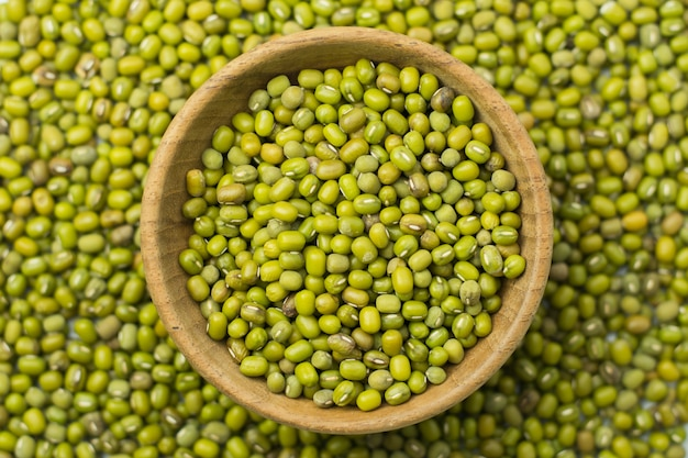 Mung beans in wood bowl background