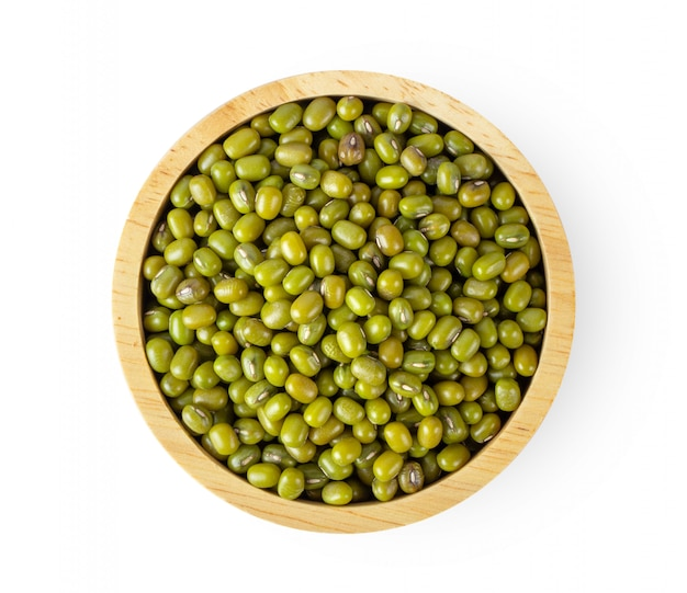 Mung beans in wood bowl isolated on white background. top view