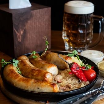 Munich sausages  sauerkraut. grilled sausages