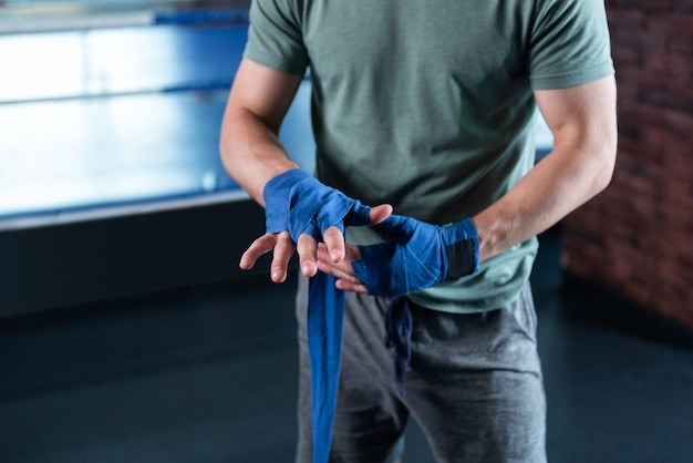 Muscle hands. top view of muscle hands of professional young promising fighter spending his time in gym