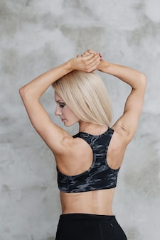 Muscled athlete woman posing