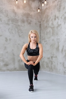 Muscled athlete woman training