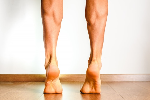 Muscles of the posterior leg, soleus and gastrocnemius muscle, photo of an athlete.