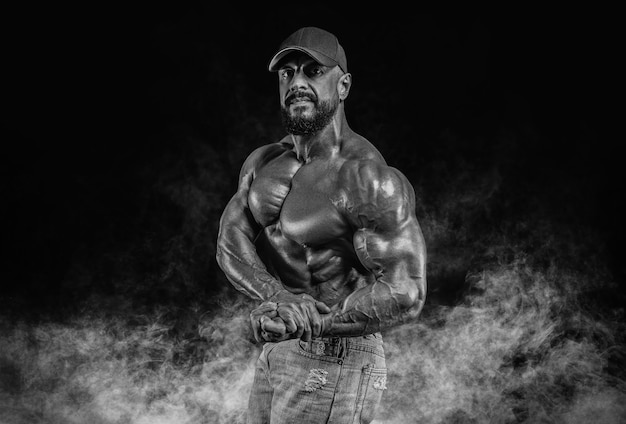 Muscular athlete posing. fitness and classic bodybuilding concept.