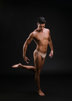Muscular ballet dancer on one leg