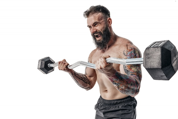 Muscular bodybuilder guy doing exercises with weigths