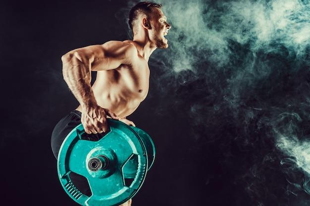 Muscular bodybuilder handsome men doing exercise