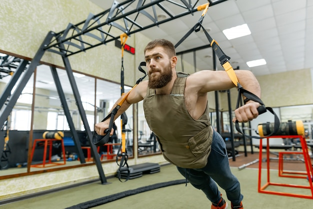 Muscular caucasian bearded man doing exercises