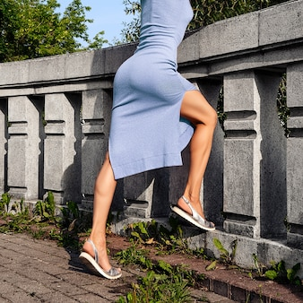Muscular female legs on observation deck