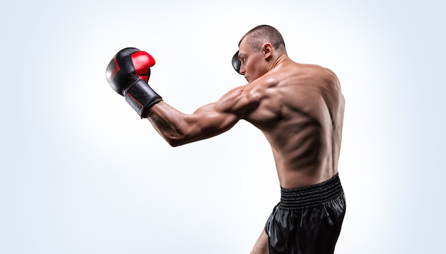 Muscular fighter boxing. mixed martial arts concept.