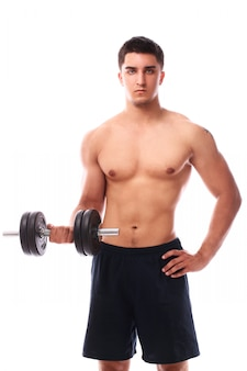 Muscular guy working out with dumbbell