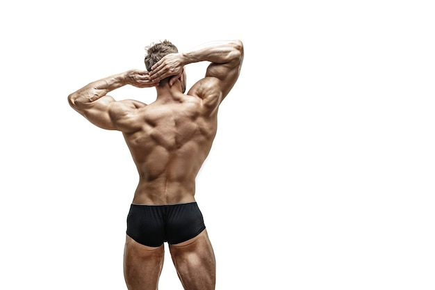 Muscular male back over white wall, isolate