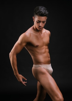 Muscular male in dancing pose